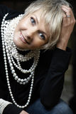 Happy woman with pearls stock images