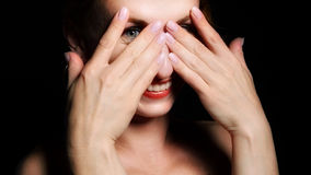 Happy woman peeping Stock Photos