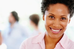 Happy woman with people in background Royalty Free Stock Image