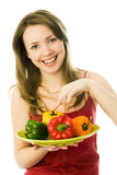 Happy woman with peppers Stock Photos