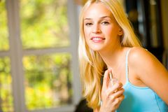 Happy woman with perfume royalty free stock photography