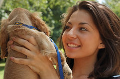 Happy woman with pet dog Royalty Free Stock Image