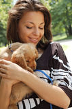 Happy woman with pet dog Royalty Free Stock Images