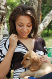 Happy woman with pet dog Stock Images