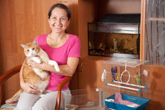 Happy woman with pets royalty free stock images