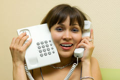 Happy woman on the phone. Stock Images