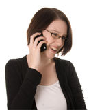 Happy woman on phone. A happy young woman recieves good news on a cell or mobile phone Stock Photo