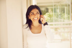 Happy woman on the phone Royalty Free Stock Images