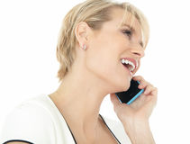 Happy Woman On Phone. Beautiful smiling elegant woman indoors talking on mobile phone Stock Image