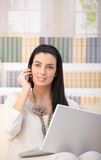 Happy woman on phone call at home Royalty Free Stock Photos