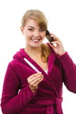 Happy woman with phone informing someone about positive pregnancy test Stock Image