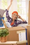 Happy woman on phone at moving Stock Photo