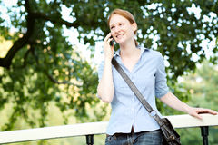 Happy Woman on the Phone in a Park Stock Photography