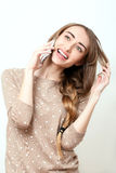 Happy woman phone talking. Face with toothy smile. Beauty stylish blonde woman with pink lips and perfect makeup posing in studio Royalty Free Stock Images