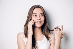 Happy woman phone talking. Face with toothy smile, isolated over white Stock Images