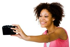 Happy woman photographing herself Stock Photography