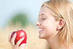 Happy woman on picnic in wheat field Stock Image