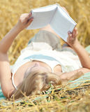 Happy woman on picnic in wheat field Stock Photography