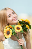 Happy woman on picnic in wheat field Royalty Free Stock Photography