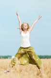 Happy woman on picnic in wheat field Royalty Free Stock Photos