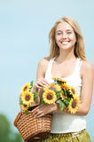Happy woman on picnic in wheat field Stock Images