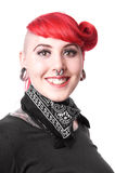 Happy woman with piercings. Young woman with facial piercings and tattoos stock photography