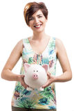 Happy woman with a piggy bank Stock Photo