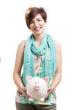 Happy woman with a piggy bank Stock Photography