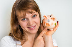 Happy woman with piggy bank Royalty Free Stock Image