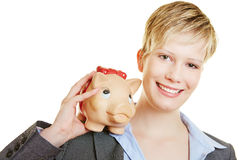 Happy woman with piggy bank on shoulder Stock Photos
