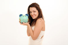 Happy woman with a piggy bank Royalty Free Stock Photo