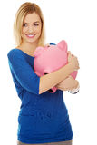 Happy woman with piggybank. Royalty Free Stock Image