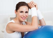 Happy woman with a pilates ball stock photos