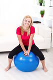 Happy woman in pilates ball Stock Photos