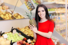 Happy Woman with Pineapple Fruit in Supermarket Royalty Free Stock Photo