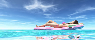 Happy woman on pink air bed Stock Photos