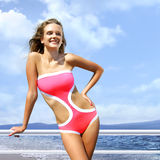 Happy woman in pink bathing suit Stock Photography