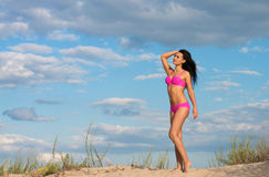 Happy woman in pink bikini Stock Photo