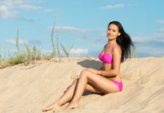 Happy woman in pink bikini Stock Images