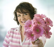 Happy Woman and Pink Daisies Stock Photos