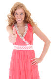 Happy woman in pink dress showing thump up Stock Photo