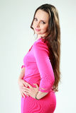 Happy woman in pink dress standing Royalty Free Stock Images