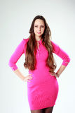 Happy woman in pink dress standing Royalty Free Stock Photography