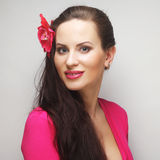 Happy woman with pink flower in the hair Royalty Free Stock Photos