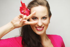 Happy woman with pink flower in the hair Royalty Free Stock Photography