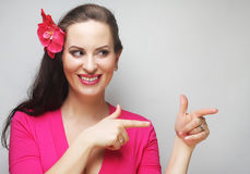 Happy woman with pink flower in the hair. Young happy woman with pink flower in the hair Stock Photos