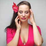 Happy woman with pink flower in the hair Royalty Free Stock Photo