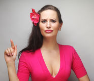 Happy woman with pink flower in the hair. Young happy woman with pink flower in the hair Royalty Free Stock Photo