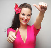 Happy woman with pink flower in the hair. Young happy woman with pink flower in the hair Royalty Free Stock Image