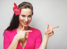 Happy woman with pink flower in the hair Stock Images
